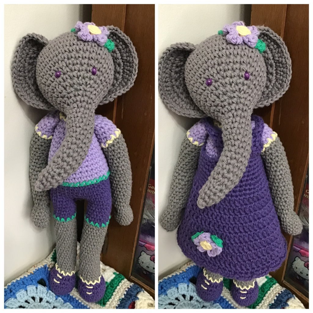 Elephant doll in dark grey with purple t-shirt and shorts and in a purple dress