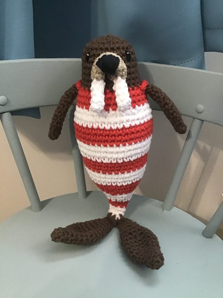 Walrus stuffie in an old time bathing costume