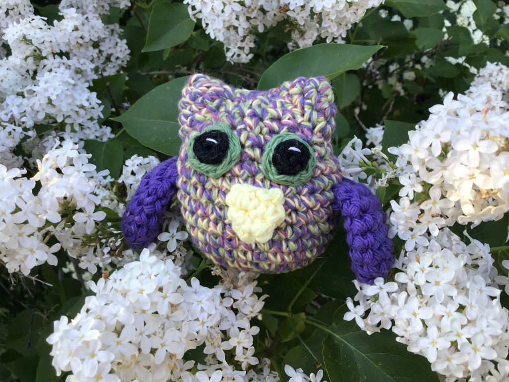 Tiny horned owl in purple vintage colours